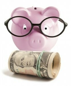 Knowing the Family Finances - piggy bank with glasses staring at a money roll