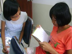 20-Sisters assisting and practicing speech