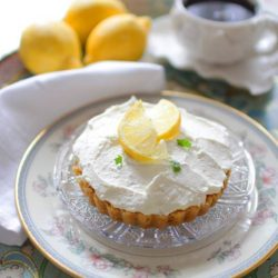 Lemon Cheesecake Mousse with crust on glass plate