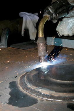 Image of a proper way to weld with a MIG gun