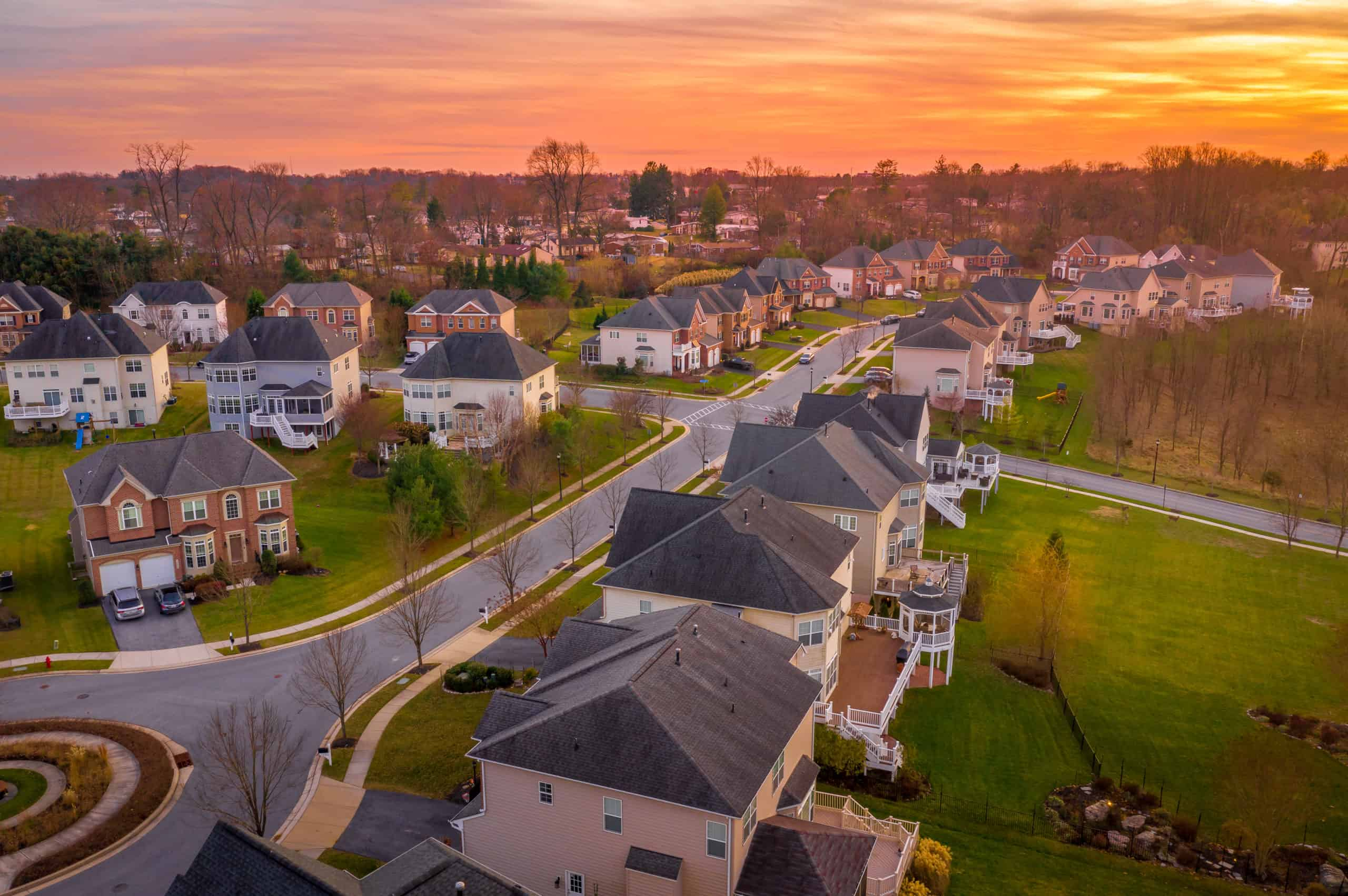Aerial view of neighborhood at sunset