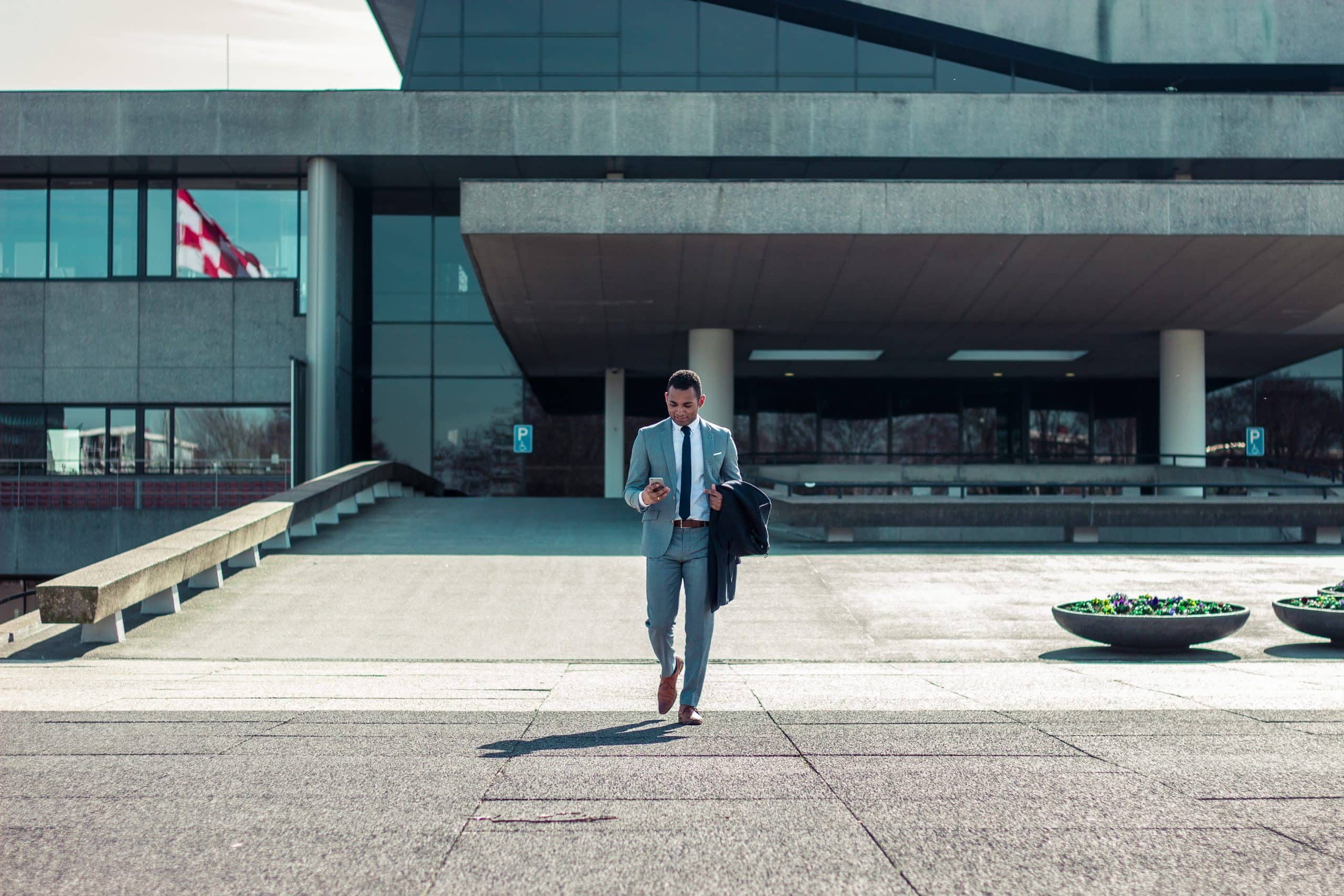 man walking in front of a building