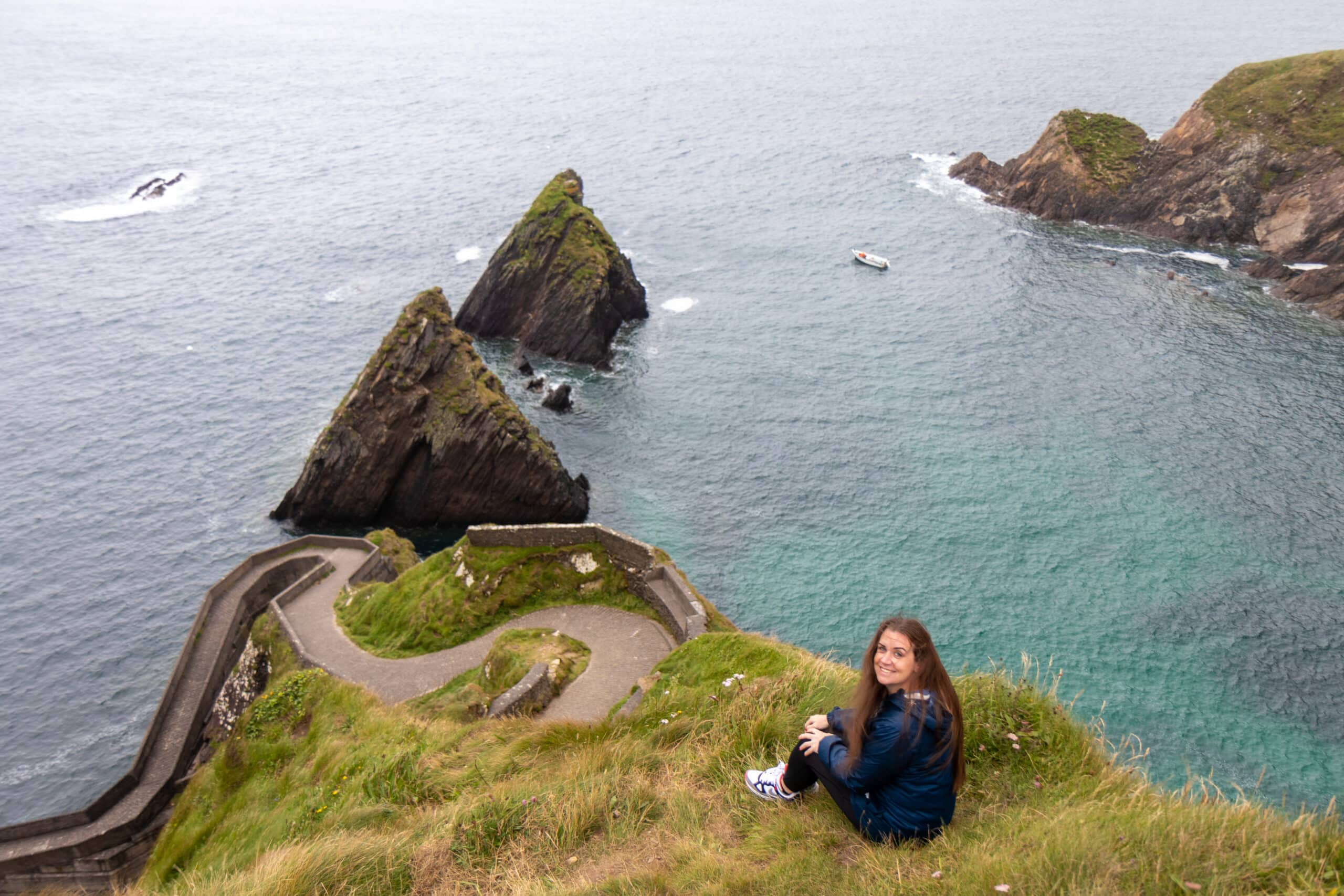 Melanie May Content Creator on a cliff by the sea in Ireland