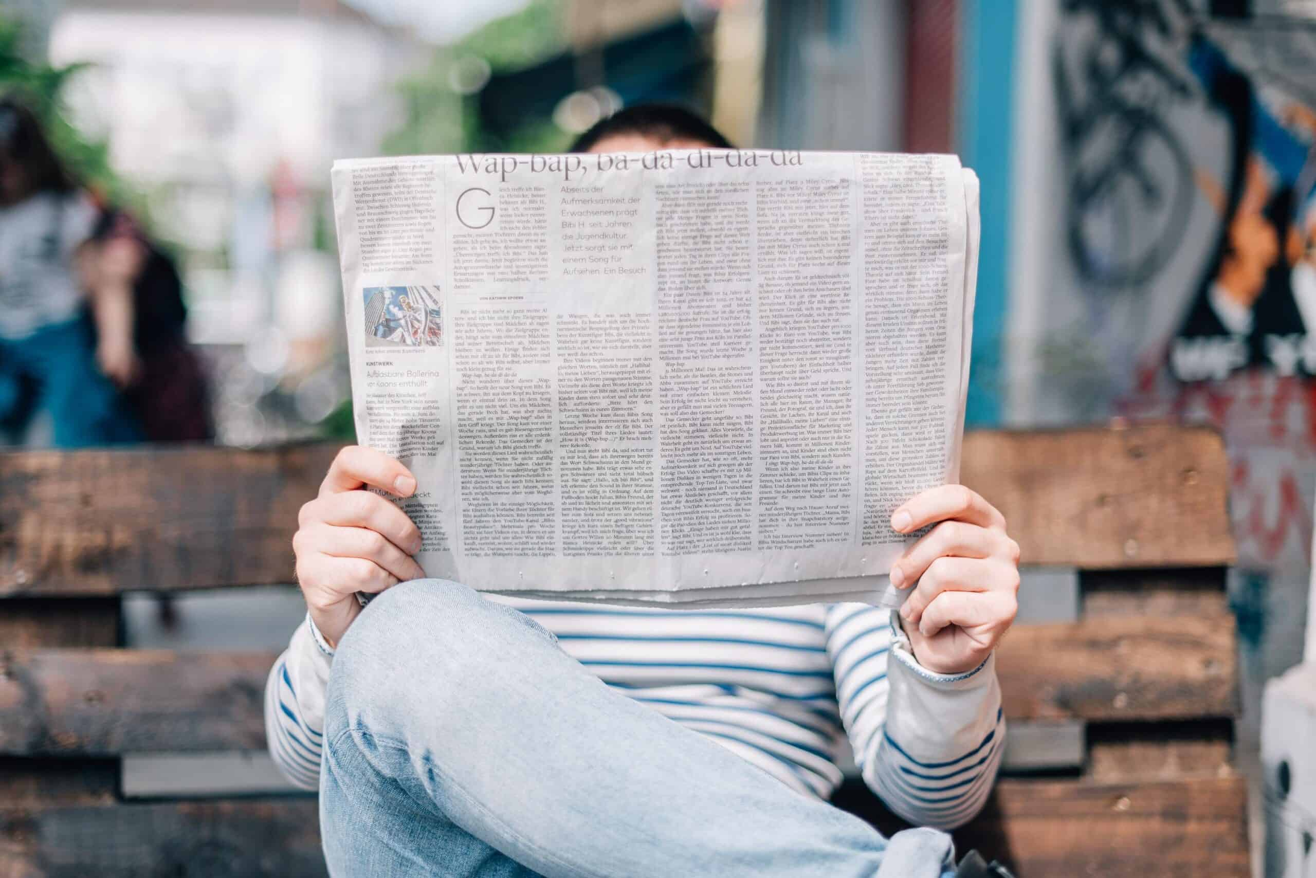 Structured Content (Relevance & Context)reading newspapers comparing traditional to digital marketing web design blue dolphin