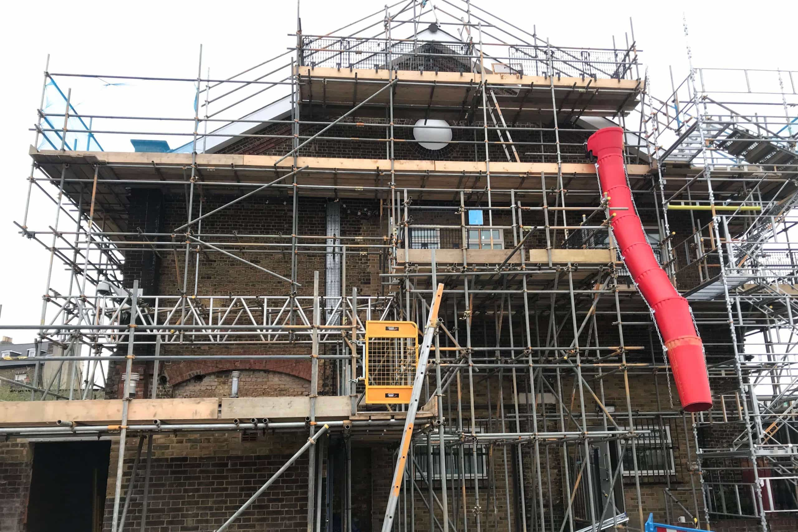 Norwood junction large commercial air conditioning solution by SubCool FM exterior of building with scaffolding