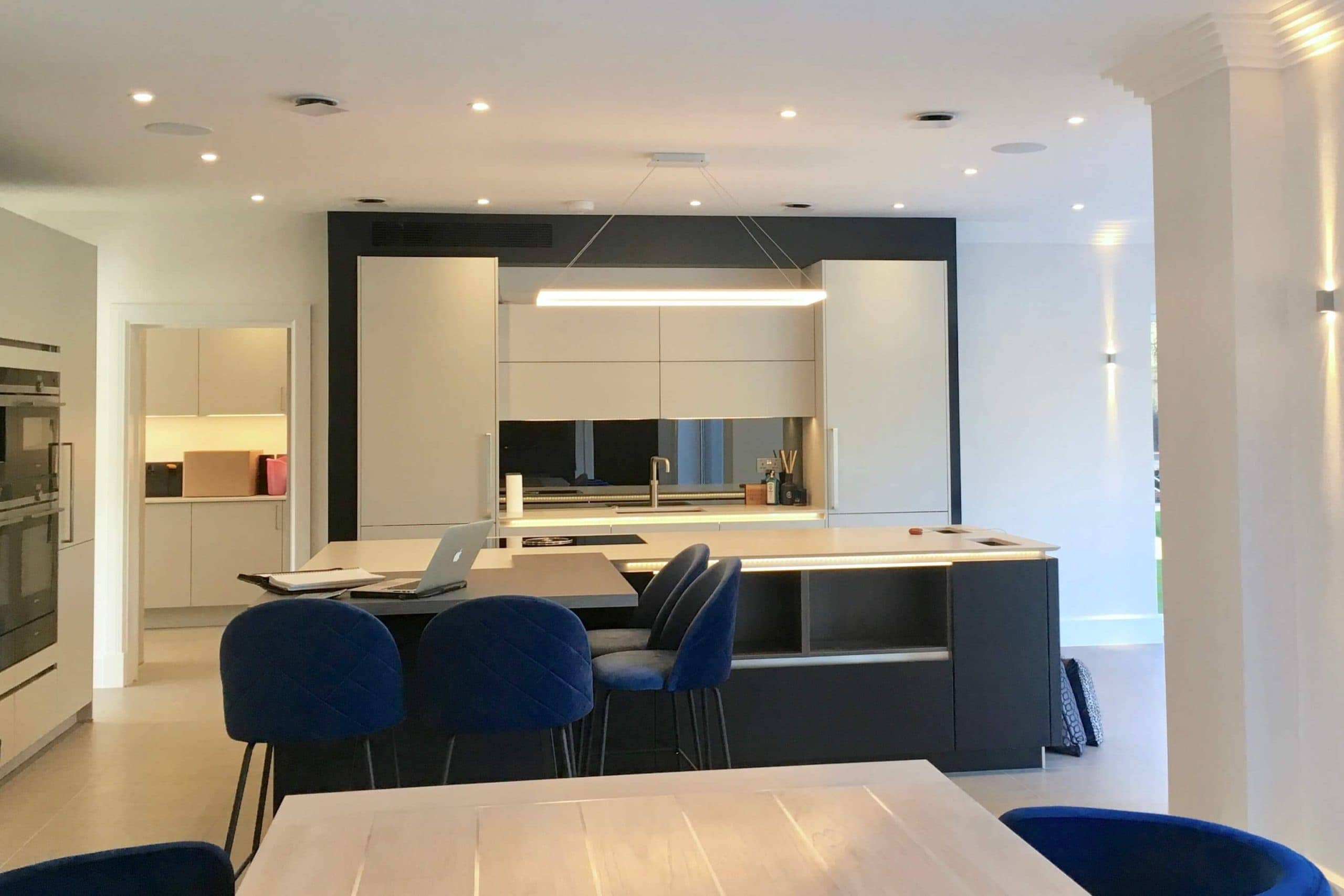 Scandia Hus new build kitchen with invisible Mitsubishi air con grill and MVHR system by SubCool FM view from dining area