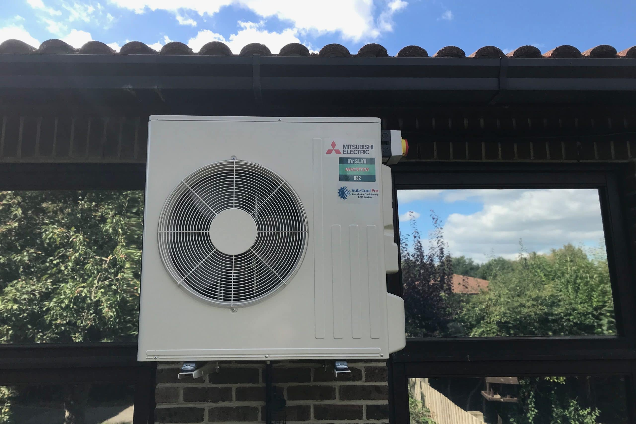 External Mitsubishi Electric air conditioning unit at primary school