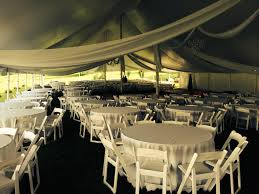 folding round table Setting inside a Tent