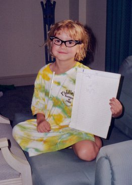 Image: Liesl as a kid playing teacher wearing glasses