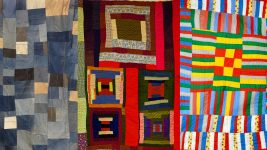Image: collaged image of 3 Gee's bend quilts made of various colors of fabric