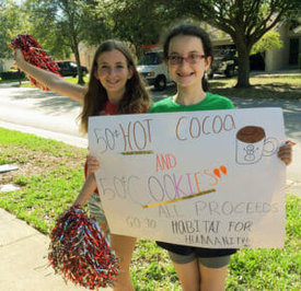 Rachel Newman (right) and her friend Felicia Gal (left) sold treats to raise money for Habitat Collier. Courtesy: Leigh Ann Newman