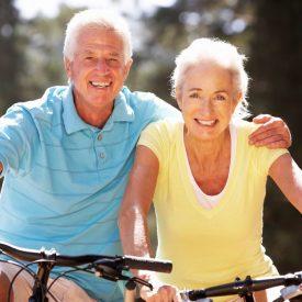 senior couple riding on bikes together