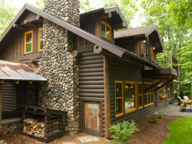 combination of solid stain color of siding and semi transparent log cabin exterior paint