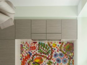 laminated fabric backsplash behind stove only in an eclectic kitchen