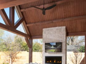 modern patio with outdoor gas fireplace and wall mounted tv