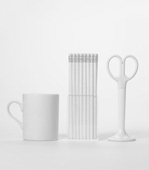 Image shows a mug, pencils and scissors. The image is used to depict Training Central's brand identity which defines the style of our learning and development materials.