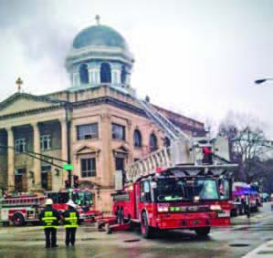 Fire trucks blocked Ashland Avenue as firefighters put out the blaze at St. Basil's Greek Orthodox Church. (Photo by Carol Scherer)