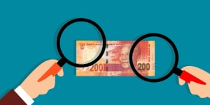 Magnifying glass on South African rand note