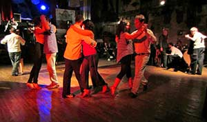 People dancing in a milonga, or tango dancehall in Buenos Aires