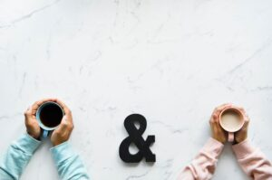 couple holding coffee cups