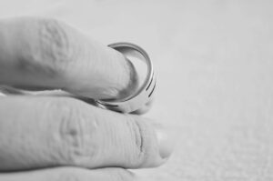 hand holding wedding ring