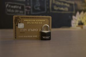 american express credit card with a lock in front of it