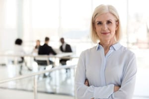 Confident lady business coach team leader posing in office, port
