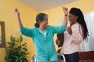 nurse and patient cheering together