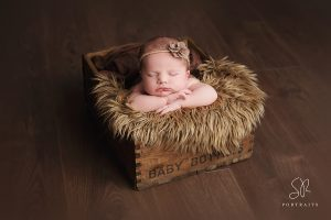 Newborn Photographer SR Portraits Leicester wood photos baby in wood box with brown headband