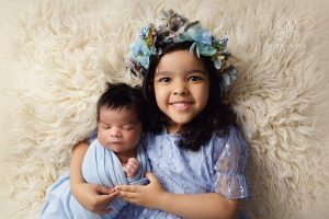 Sibling girl with baby brother newborn photography SR Portraits Leicestershire