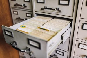 open filing cabinet drawer that is full