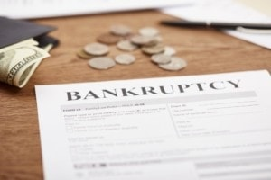 Bankruptcy Forms and moeny on a table