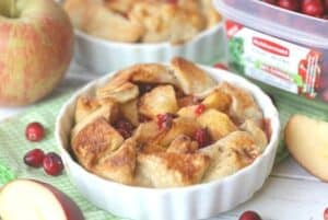 Sweet apples and tart cranberries collide to make these delicious Apple Cranberry Tarts. These mini apple pies are the perfect recipe for your fall celebration. This cran-apple pie recipe is perfect the perfect portion for dessert. Try this easy apple pie recipe.