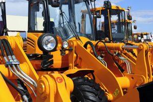 Close-up of orange farm tractors