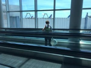 boy at airport with stuffed animal