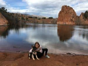 girl and dog by lake