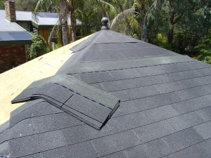 Courses of asphalt shingles running up the roof