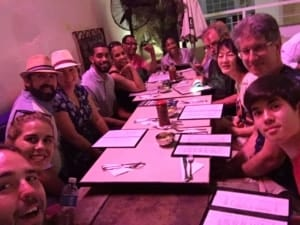 a group photo of us eating dinner at del frente in havana