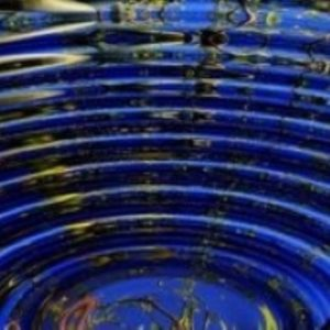 Concentrec ripples on deep blue water