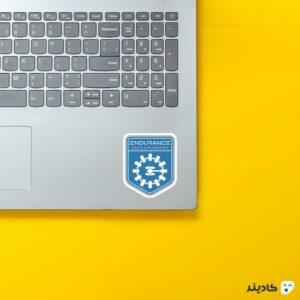 استیکر لپ تاپ ماموریت استقامت روی لپتاپ