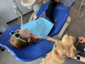 Children's dental appointment with a therapy dog
