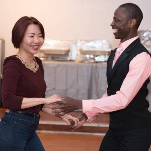 Instructor and client dancing