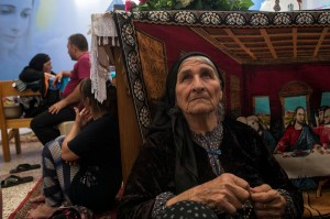 Farida Pols Matte, 80, in Ankawa, Iraq, with her family and other Iraqi Christian refugees. They are among the hundreds of thousands of people displaced by the Islamic State in Iraq and Syria. Credit Lynsey Addario for The New York Times