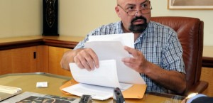 Alex Prodes, handling supporting documents, during the interview to TNH about his abuse.
