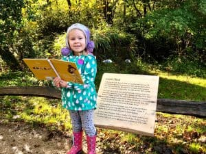 L Reading her favourite book at Heligan Gardens