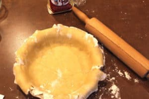 Ready to crimp the edges. For an unbaked pie like Lemon Meringue, prick the crust a few times before baking. Add pie weights or beans to maintain shape. For Pumpkin Pie, however, you just fill it and bake it with the filling. (No pricking.)