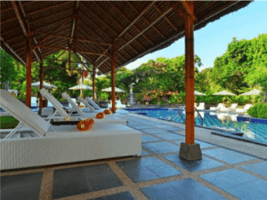 The pool area of Inna Sindhu Beach Hotel spacious and large enough to swim laps