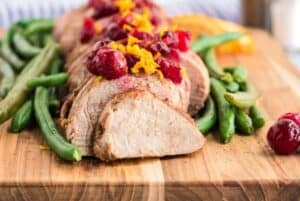This Slow Cooker Pork Tenderloin With Cranberries & Orange is a delicious fix it and forget it holiday Crock Pot recipe.