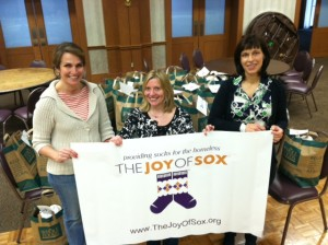 Three Moms who helped conduct a sock drive for the homeless at Shir Ami Synagogue, Newtown, PA for The Joy of Sox, a nonprofit that provides joy to the homeless with new socks.