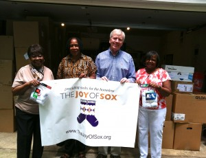A local chapter of Charms Incorporated presented Tom Costello Jr, Chief Sock Person of The Joy of Sox, with over 800 new pairs of socks for the homeless.  Pictured with Tom are (l to r) Joyce Gibbs, Barbara Monley and Pat Matthews.